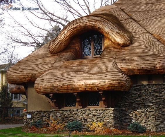 Oversized Rolled Roof Edges Coupled With The Random Flowing Wave Pattern Make This Cedar Roof A Standout Natural Homes Shingling Unusual Homes