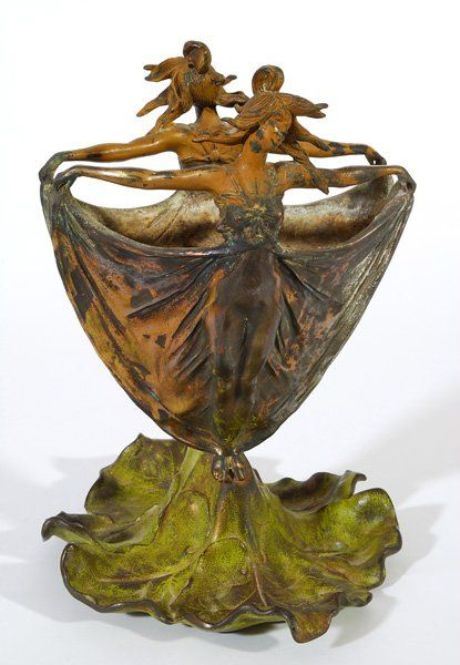 Metal double-sided vase of woman with outstretched arms, circa 1930's