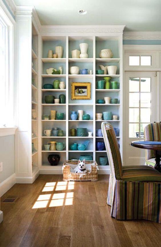 floor to ceiling shelves accommodate architect skip sroka s collection of vintage mccoy pottery. Black Bedroom Furniture Sets. Home Design Ideas