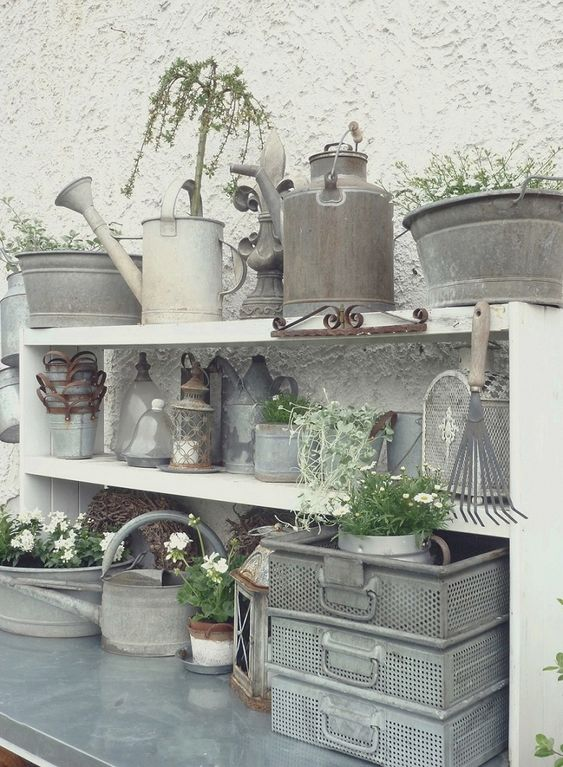 Potting Bench and gardening supplies!!! Bebe'!!! Love the zinc watering cans and pails and bowls!!!