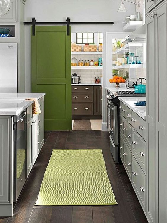 Integrate grays & brass hardware with a color (maybe navy) on sliding door for laundry (bathroom) area.