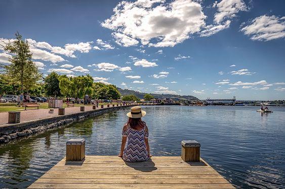 Rotorua - Woman on Lake Rotorua jetty