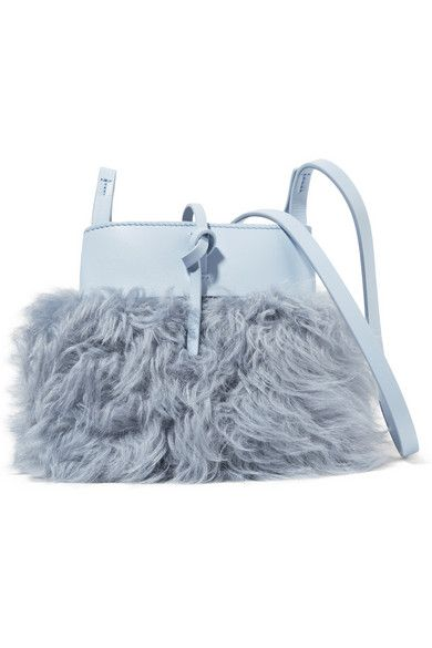 kara Sky-blue shearling and leather (Cow) Tie fastening at open top Weighs approximately 0.7lbs/ 0.3kg  Imported