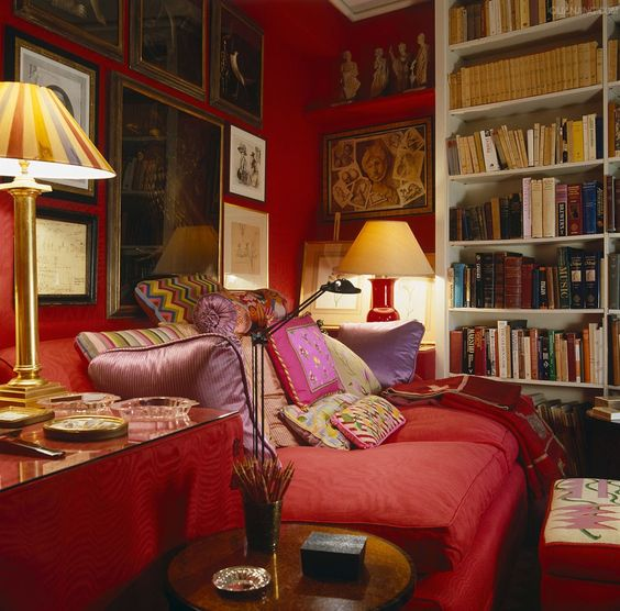 John Stefanidis English library ~ The walls of the small Red Library are clad in scarlet hand-woven silk moire and the red sofa is covered with needlepoint pillows.