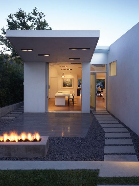 White Color Small Summer House Design With Pathway Concrete Pavers