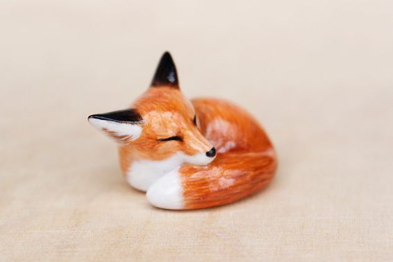 Little hand-painted sleeping red fox figurine. It is hand formed from polymer clay, carefully painted with acrylic paints and finished with glossy water