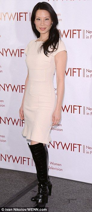 Slender: Lucy showed off her gorgeous figure in the dress