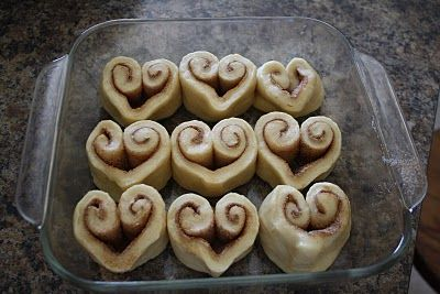 See Idea .. click photo   When rolling dough for cinnamon buns, take EACH end and roll INWARDS. Then pinch to get the heart shape. See photos