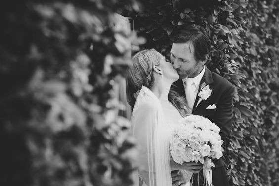 Kat Stanley Photography :: Black and white photography :: Kiss :: Bride :: Groom :: Flowers :: Wedding photo