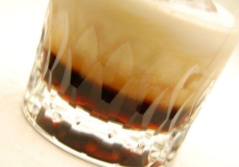 Smith and Curran  2-1/4 oz dark creme de cacao  1 oz half & half  seltzer