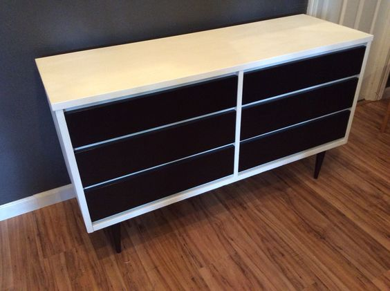 This mid century modern dresser had the drawers stripped and stained with the outside painted white.