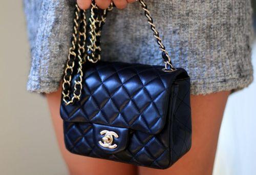 Chanel mini classic flap bag, black lambskin with gold hardware.