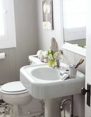 Save money on your bathroom remodel with salvaged finds, like this pedestal sink—a bargain at $75