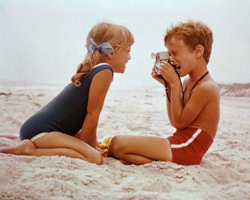 Boy Photographs Girl on Beach - 1960s, New York State