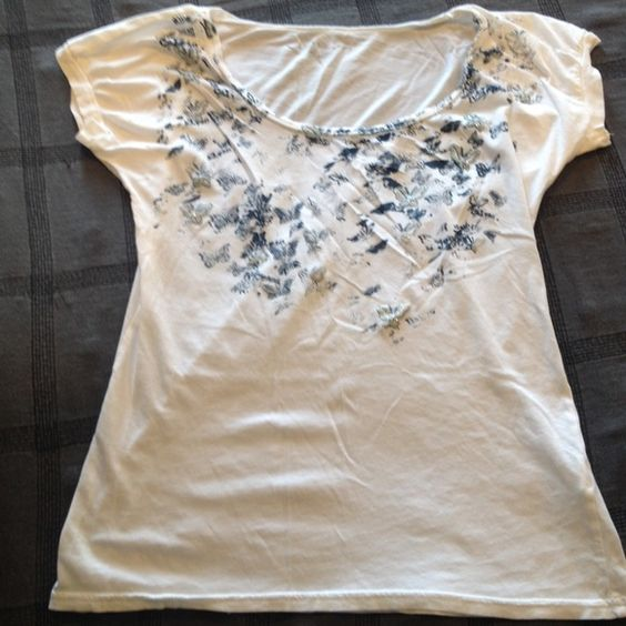 White Calvin Klein Shirt! Gently used but in good condition! Glittery butterfly detail at the top around the neck :) Very cute! Perfect for summer Calvin Klein Tops Tees - Short Sleeve