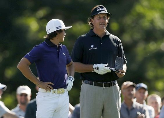 Phil and Rickie Fowler chat during a practice round