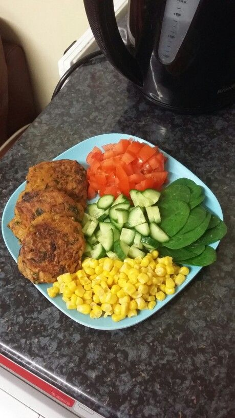 Salmon & sweet potato fishcakes served with salad ❤ Recipe for fishcakes: boil a skinless sweet potato in water with salt, drain and mash. Add tinned salmon flakes, fresh chopped corriander, diced red onion, pinch of salt, spices (I used Shan packet mix 'Shami kebab'), paprika, fresh lemon juice, tomato puree, 1 egg, and some cornflour. Mix with a fork well until all of the ingredients are combined well. Heat a nonstick pan with a drop of oil and spoon the fishcake mixture into the pan. Cook…
