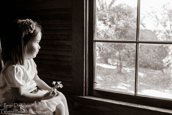 Taken on the second story of an old old carriage house - here Baby G is looking out to the world! Made this one sepia to fit the surroundings. Kids picture, black and white, little girl looking out a window, county setting, sepia, children photographer, corona