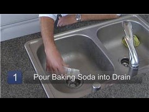 Clean dirty kitchen drain with baking soda as a drain cleaner