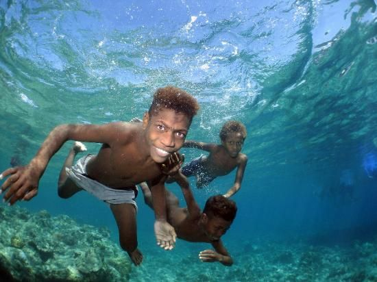 Kids Swimming Underwater melanesian kids swimming under water in solomon islands
