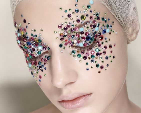 Embellishments!! Face art - nude lips and pale skin make the multicolored embellishments really pop