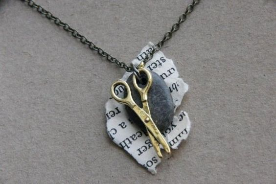 Rock paper scissors necklace.