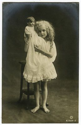 circa 1918 vintage Cute Little BLOND GIRL with DOLL antique photo postcard: