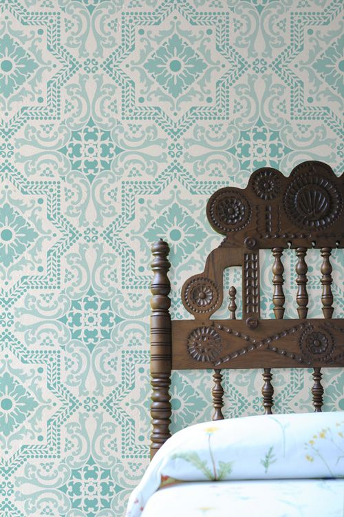 Turquoise Spanish tile inspired stenciled wall in a bedroom. Come find Beachy Turquoise Decor Inspiration to float your boat! #turquoise #decorinspiration #bedroomdecor #stenciledwall #exoticdecor