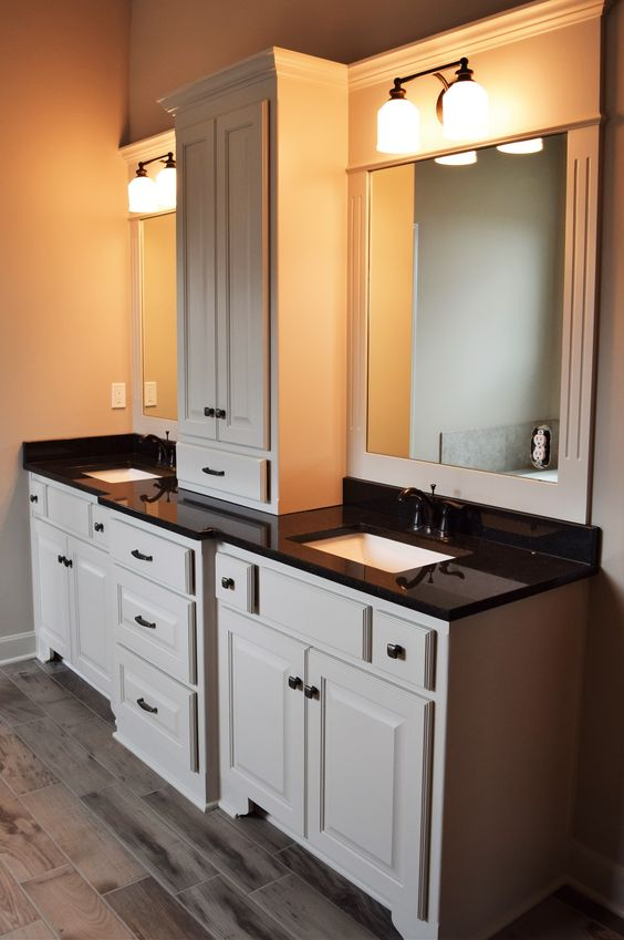 black granite with ORB faucets in MBath - white cabinets - linen tower