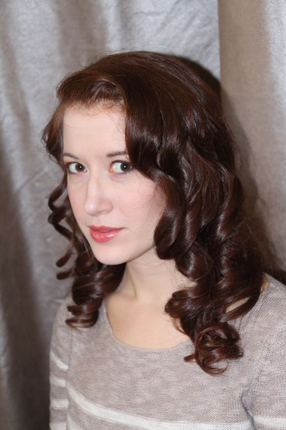 Curls and waves are what we are wearing for this spring. Style done by Francesca. #lamiragesalon