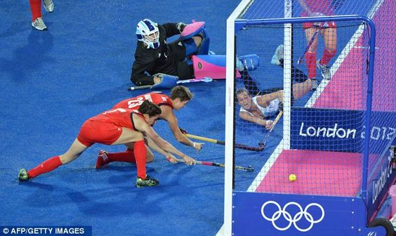 Floored: Carla Rebecchi of Argentina (right) dives to score a goal. Manso GOL!