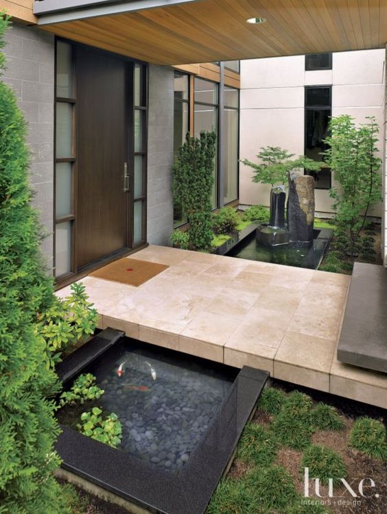 Modern front entry with pocket garden landscape by for Contemporary pond design