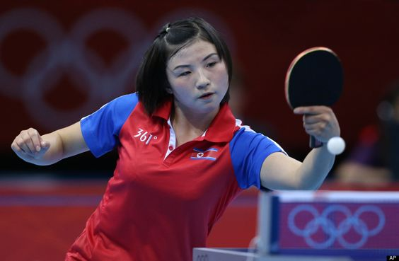 North Korea's Kim Jong returns a shot to Great Britain's Na Liu during the women's team table tennis competition at the 2012 Summer Olympics, Friday, Aug. 3, 2012, in London.
