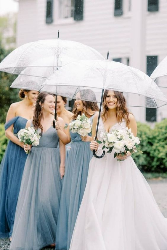 Set in the countryside with lots of greenery, neutral blooms, and charming garden touches, @sophiefelts helped bring this wedding dream to life. All details on SMP! #stylemepretty #weddingrain #rainwedding #virginiawedding #classicwedding