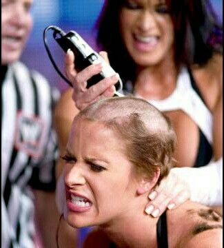 Women getting head shaved