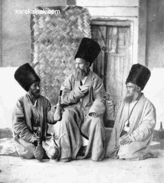 Three Khivans drinking tea in the courtyard of their home. - Photographed by A. S. Murenko in 1858.: