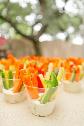 Veggie cups, bow tie pasta salad, sandwiches cut in bow tie shape, blue popcorn, cup cakes with bow tie toppers, fruit salad