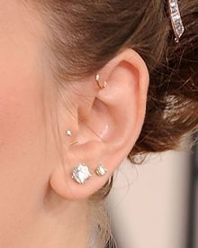 craving a new piercing...thinking about getting a front helix (that one with the little hoop above the tragus)