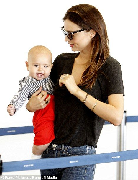 love her jeans and rings. oh and baby Flynn.