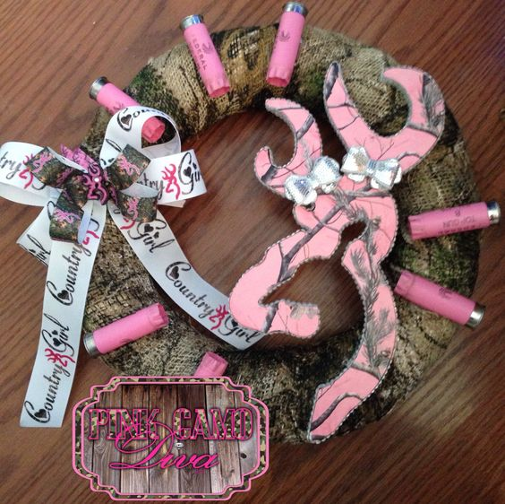 """14"""" pink Realtree camo Browning Buckmark inspired BLING Country Girl wreath! Finished off with matching bow and some spent pink 12g shotgun shells! This is a must have for any Country girls house, bedroom, barn, and/or anywhere else! Please email us for orders at mailto:pinkcamodi..."""