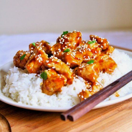 A takeout favorite made right at home in under 30 minutes - Crispy Honey Sesame Chicken!