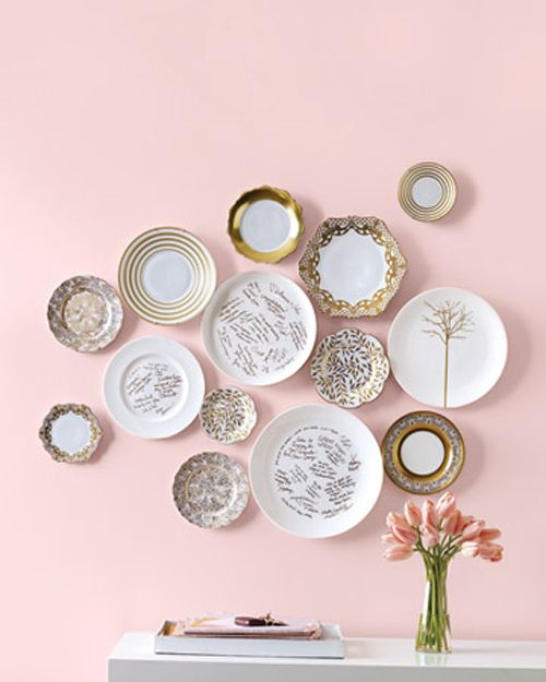 Pink wall,gold and white plates: