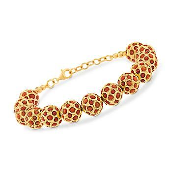 Hailing all the way from India, this coral bead bracelet is designed with precise cagework over bold Navratna beads.