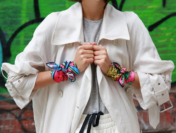Trending Fashion Style: The Scarf.  Leandra Medine A.K.A The Man Repeller in cute watermelon and pineapple fruit illustration print scarves wrapped around her hands as cuffs, street style 2014.