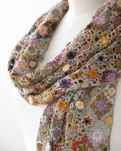 a crochet scarf that balances the weight of the craft with the gage of yarn and use of color to a wow.:
