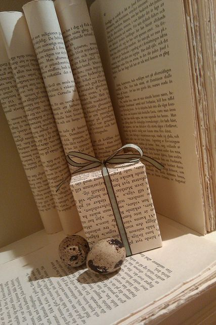 Bookmas  Book wrapping paper! Talk about cheap! lol. And you could also stamp red stars on this for christmas!