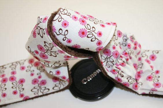 Would love this to cover up my dingy camera strap... and maybe keep me from always losing my lens cap