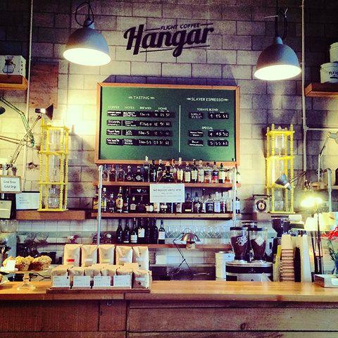 Vogue's Guide to the Coolest Little City in the World: Wellington, New Zealand | Flight Coffee's Hangar | BOUDI enamel cloche lighting - www.boudi.co.nz