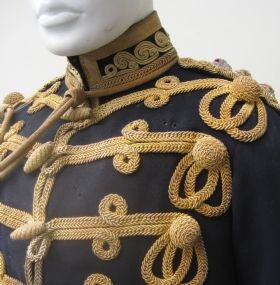 An Officer`s 7th Hussar`s field rank tunic and pouch