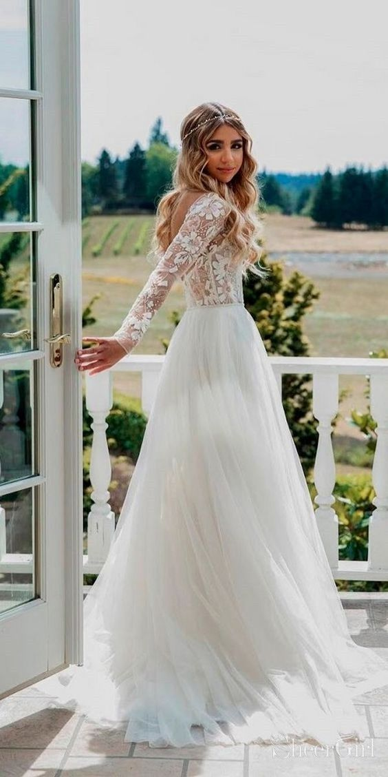 See through long sleeve boho wedding dress. Floral and